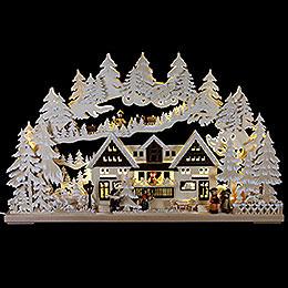 3D - Schwibbogen Weihnacht am Geschenkehaus mit Raureif  -  72x43cm