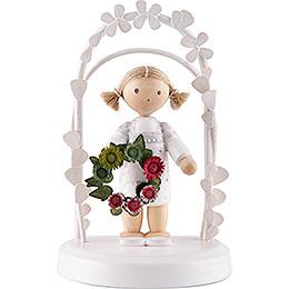 Flachshaarkinder Geburtstagskind mit Blumenkranz, grün / rot  -  7,5cm