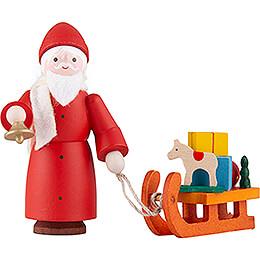 Thiel Figurine  -  Santa Claus with Sled  -  coloured  -  6cm / 2.4 inch